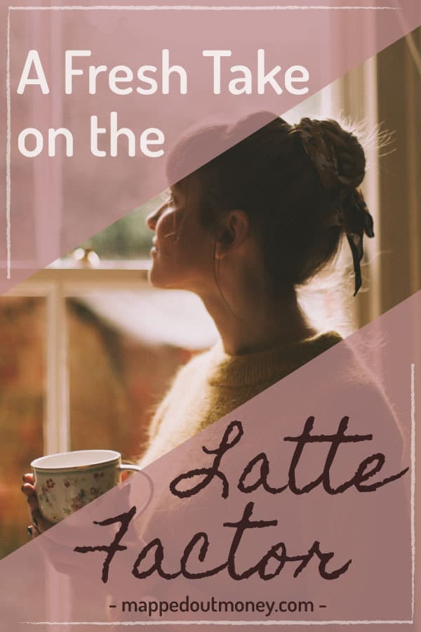 Girl looking out window holding coffee