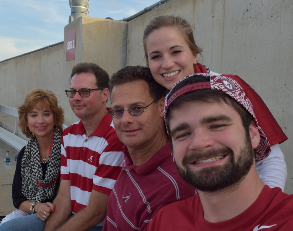 Nick, Hanna, and family at an Alabama football game